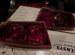 Фонари к Митсубиси Лансер 10 в крышку багажника